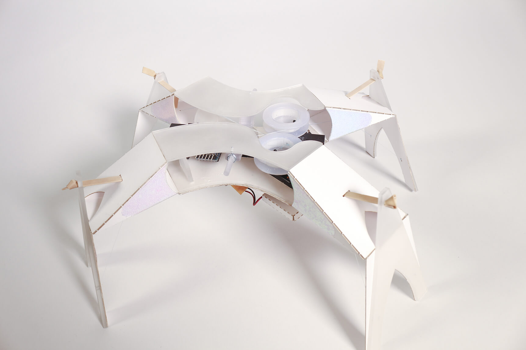 a paper robot photographed in perspective